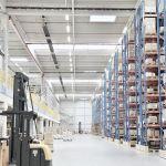 A calorSchwank [a tube heater by Schwank] under the ceiling of a warehouse.