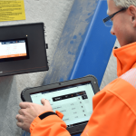 Somebody operates the SchwankControl Touch control system for heating systems by Schwank.