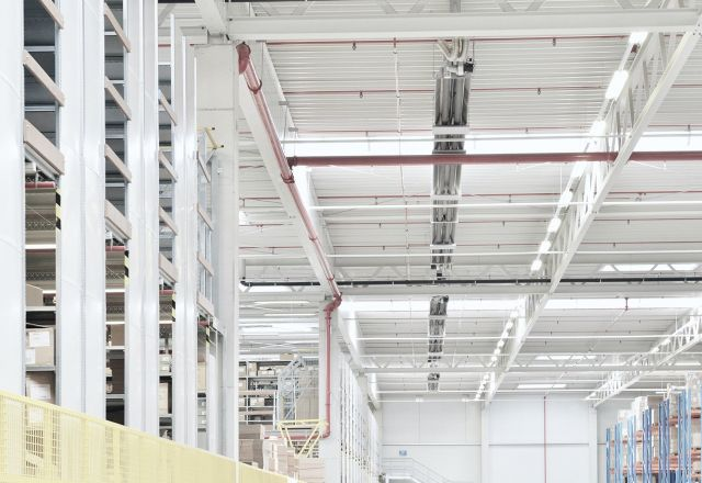 Long tube heaters from Schwank under the ceiling of an logistic building.
